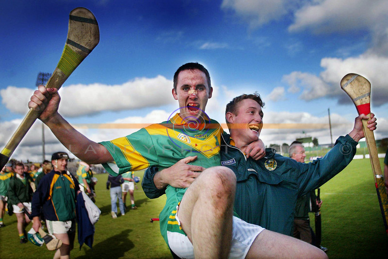 Blodied after the battle...Brendan Harris shows the sign of battle but is gallant in the celebrations with team mate .................. after their close encounter with Ballyduff in the   Kerry County Senior championship semi Final in Tralee.<br /> Pic Brendan Landy