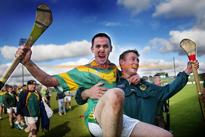 Blodied after the battle...Brendan Harris shows the sign of battle but is gallant in the celebrations with team mate .................. after their close encounter with Ballyduff in the   Kerry County Senior championship semi Final in Tralee. Pic Brendan Landy