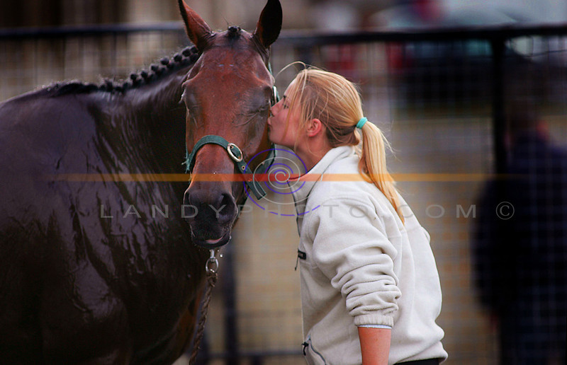 Thats my boy, stable girl Niamh Yates from Rush Co Dublin has a well rewarded kiss for Victram who won the big race inListowel on Tuesday.<br /> Pic Brendan Landy