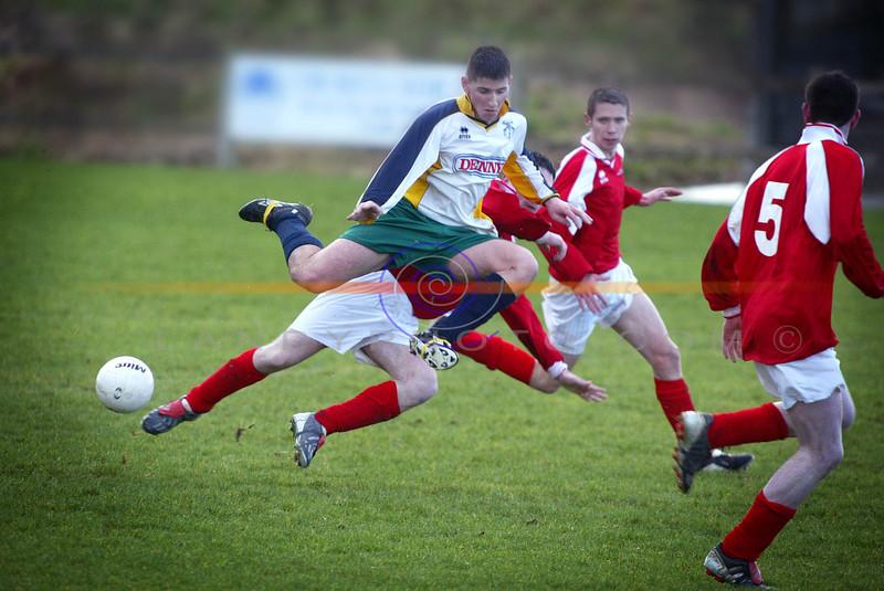 Kerrys District League  Chris Kerins caugh in mis air as he bundles off a challenge from Limerick District League player.<br /> Pic Brendan Landy