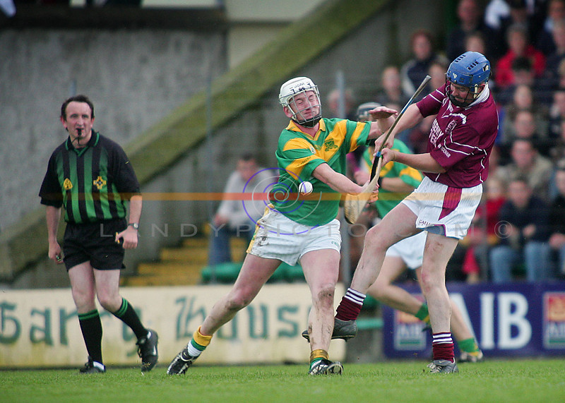 The bending of the ash...<br /> James McCarthy and   ....... intertwine their hurleys under the watchfull eye of ref Willie Barrett.<br /> Pic Brendan Landy