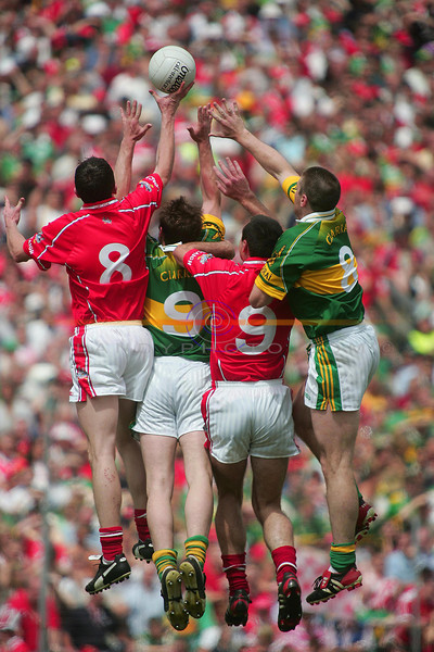 HAnd up who want the ball....<br /> The Mid Field paring of Kerrys Darragh Ó Sé and William Kirby and Corks Graham Canty and Dermot Hurley rise togeather for the ball.<br />  The Musntar Semi Final Day in Killarney<br /> 13th June 2004<br /> Pic Brendan Landy