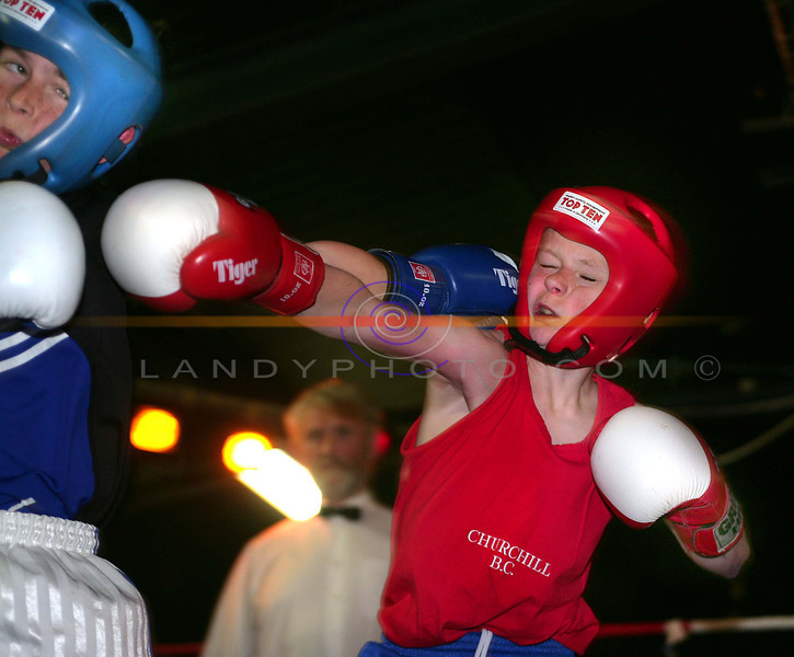 Double hit ..<br /> Kevin Burrows from Tralee in the red corner looks like he has taken one to the side of the face while in turn makes contact with  Rathlkeel's John Casey in the Cashen Vale Boxing Tournament in Lisselton.<br /> Photo Brendan Landy