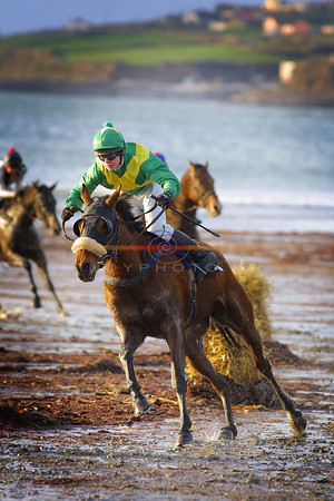 Splashing action around one of the bends at the Ballyheigue races on the strand  baked by sunshine despite the bitter cold.<br /> Pic Brendan Landy