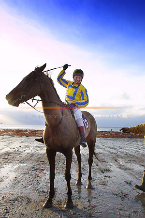Celebrations for  Denis Hogan  on Board his Horse Autum Stuff after winning the feature race at the Ballyheigue races on the beach on Sunday.<br /> Pic Brendan Landy