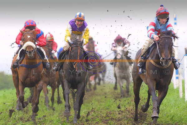 Flat out mucky action from Ballybunion races as  overall winner  Brian Carey on Johnnys Drean on the  right leads out  second place finnisher Declan Queeley on  Who's your Man , and on the left is Tralee Jockey  Phill Enright who was a faller in the race.<br /> Pic Brendan Landy