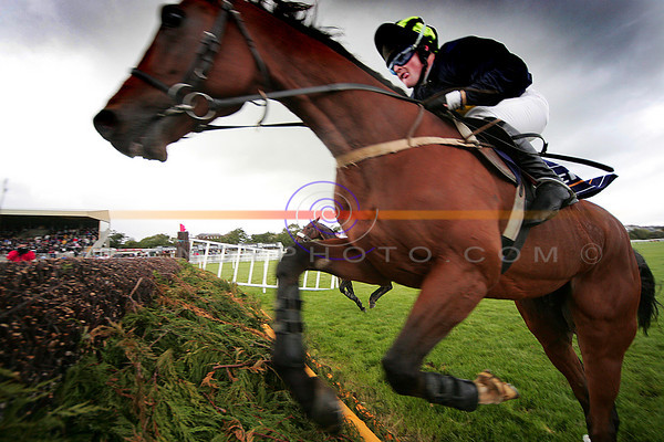 Up close and personal with the action from the steple chase racing at the festival of horse racing in Listowel.<br /> Horse Theseus   Jockey J P Elliott<br /> Pic Brendan Landy