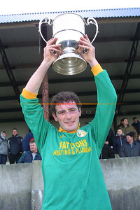 Home at Last Jack Corridan Captain of The Finuge Team Holds teh North Kerry Championship cup high. Pic Brendan Landy