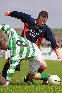 Declan Leahy (Celtic)and ? ( Park) get tangled up as they go for the ball.