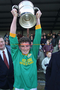 Jack Corridan captain of Finuge Raises the North Kerry Championship cup aloft.