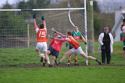 Dangerous Moments for Beales Joby Costello as Brosnas Jimmy Keane and  John Downey try to block his clearance as his team mateDeclan Bambury watches on. Pic Brendan Landy