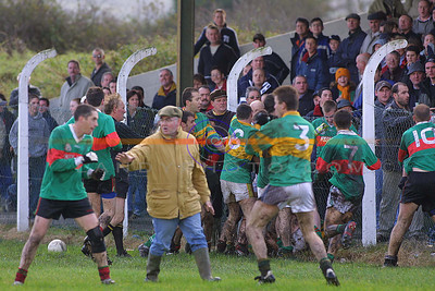 Redicluse carry on by both players and supporters as a major fracas breaks out in front of the stands between moyvane and Beale in the dying moments of the replay  first round of the North Kerry Championship. Pic Brendan Landy