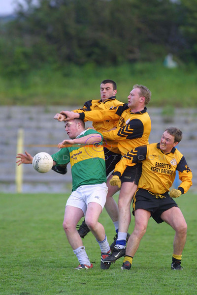 3-1  Emmets players Kieran O Sullivan, Padraigh Buckley and Pat Carmody  pile on the presure  to moyvane player David Moloney<br /> pic Brendan Landy