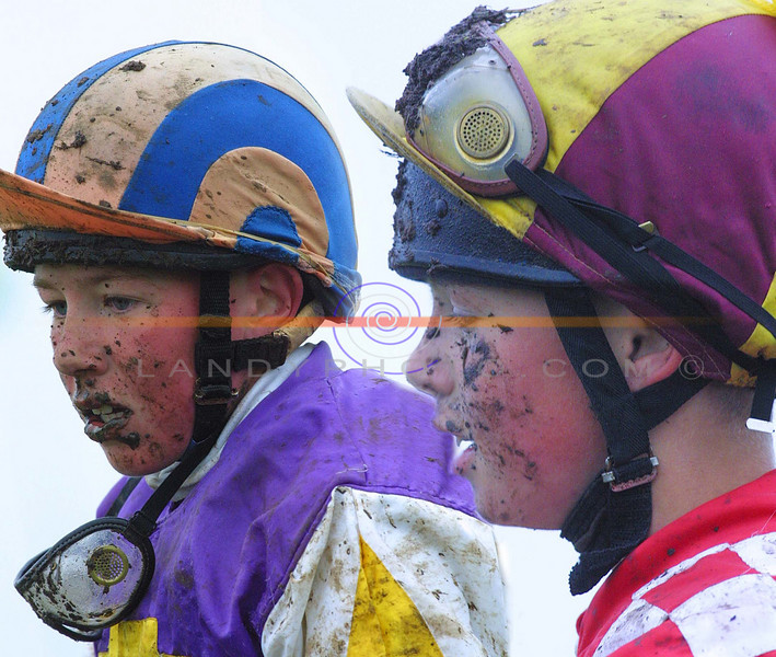Who ever said this was the sport of kings....as jockeys Declan Queely and  Glen Hunt come in exausted and splattered in mud from the  Ballybunion Guiness  Derby held in a wet and mucky sunday in Ballybunion.<br /> Pic Brendan Landy