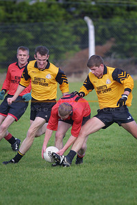 Jason Wren of Tarbert ablout to get his toe under tha ball as  Listowel Emmets Brendan Guiney and  Mikey Kennelly close in watched on by Tarberts Deo O Connor. Pic Brendan Landy