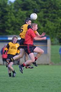 Stephen Stack Listowel Emmets and Eugene O Connell Tarbert both miss the Ball as they rise in the air  Togeather in the first round clash in Ballylongford. Pic Brendan Landy