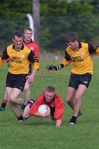 Jason Wren of Tarbert hits the deck under the presure of    Listowel Emmets Brendan Guiney and  Mikey Kennelly close in watched on by Tarberts Deo O Connor. Pic Brendan Landy