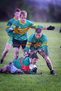 Declan Bambury clutches teh ball for Beale as  Moyvanes  Cathal O connor and Jackie Mulvihill  cover him . Pic Brendan Landy