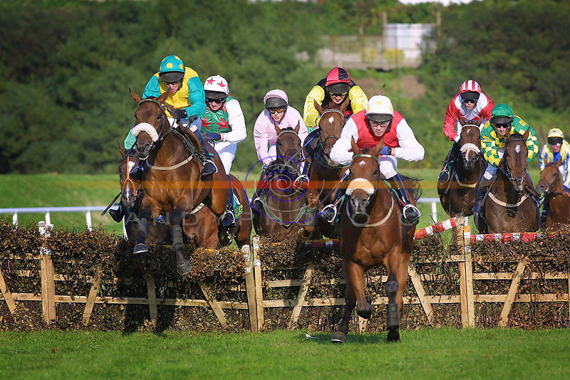 Colourfull action from a hurdle race on tuesday at the sundrenched track in Listowel.<br /> Pic Brendan Landy