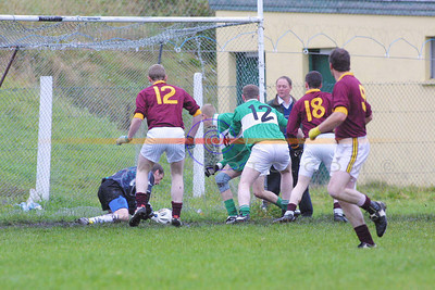 Dangersou moments for Ballydonoghue , but their goalkeeper  Batty Lynch comes to the rescue  as duaghs   Denis Lane, Colm Carmody and Brendan O Brien beat  ballydonoghues Johnny Loulihan and  Keith Hughes. Pic Brendan Landy