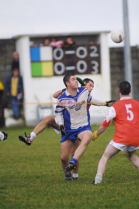 Desmonds Kenneth Dillion  and Brosnas Kieran Murphy and  no 5  Paul Curtin watch the ball, as the score reflect brosna in the Lead early into the first half. Pic Brendan Landy