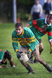 Eddie Bowler  covered in mud but still determined as he makes for goal. Pic Brendan Landy
