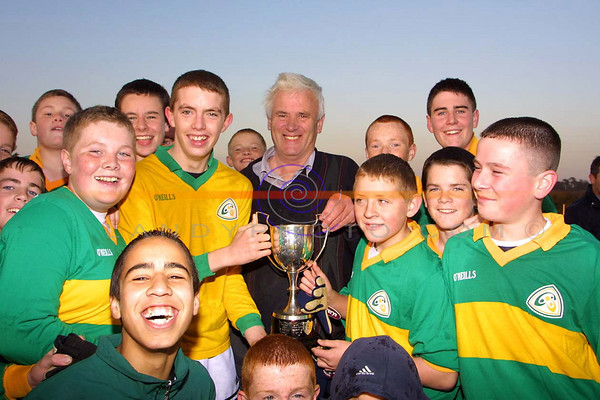 Mitchels Captain John Higgins  and his team are presented with the North Kerry Championship u/14 cup.<br /> Pic  JS/ Landy Photo