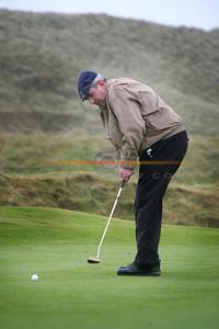 Sean Cocran  watches his put as he  partakes in the Ballybunion Golf Club Winter League . Photo Brendan  Landy