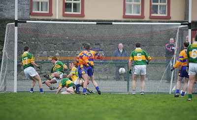 Kerry players tangle up with their goalie as claire get a second goal. Photo Brendan Landy
