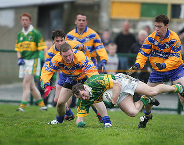 Sheamus Moynihan falls to the ground but still clutches to the ball. Photo Brendan Landy