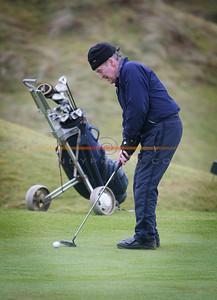 Sean o Sullivan  makes his put on the 18th as he partakes in the Ballybunion Golf Club Winter league. Pnhoto Brendan Landy