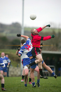 Twisted in Motion Tarberts  Kevin Wren gets airbourn with  A Walsh of BAllylongford. Photo Brendan Landy