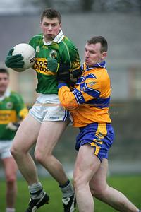 Tomas o Sé takes a knock  from clares  David Russell. Photo Brendan Landy