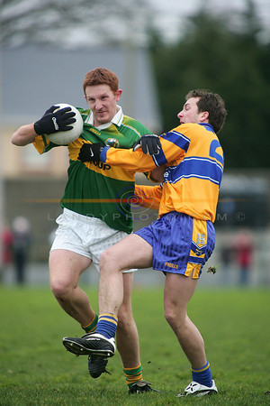 Noel Kennelly tries to hold off Clares no 29 in the friendly game in Listowel. Photo Brendan Landy