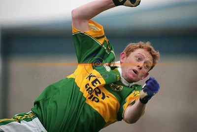 Colm Cooper dives dramaticaly  with a punch of the ball towards goal. Photo Brendan Landy