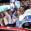 Bedford Blues fans celebrate at Twickenham.