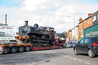 Steam locomotive leaves Kidderminster Station by road,
