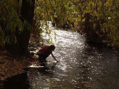 Merrill Warren gathers water from Bozeman Creek during the Gallatin Microplastics Initiative preliminary sampling. Photo by Emily Stifler Wolfe