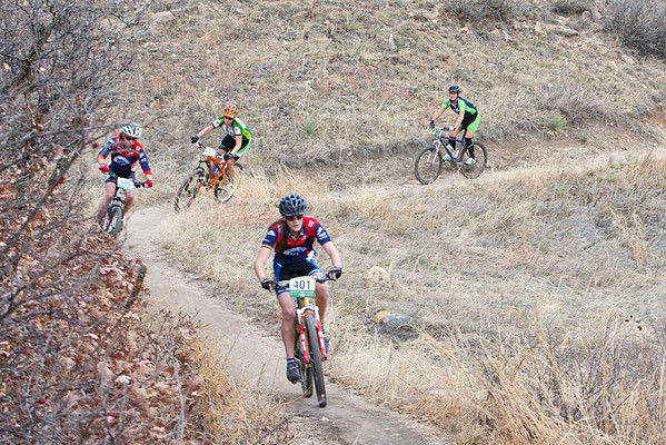 Clare Baker, Sophomore D2, Vail Valley Composite chased by team mate Hannah Hardenburgh, and Leader Erin Quinn, Team Evergreen Composite and Fort Collins riders. Photo Carrie Dittmer.