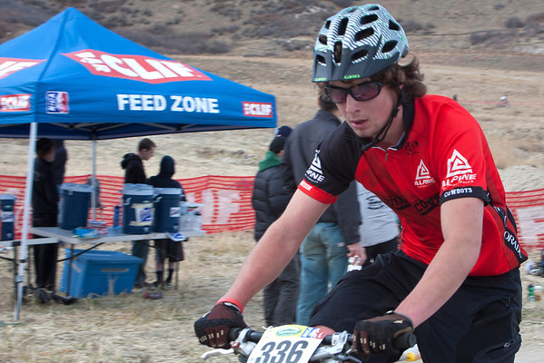 Taran Reinecke, JV D2, Gunnison High School, comes through the Clif Bar Feed Zone. Photo Carrie DIttmer.