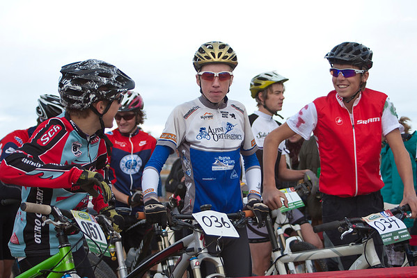 Isaac Stackonis (51), from Salida High School, chats with Josh Gallen (36) from Crested Butte, and Stephan Davoust (34) from Durango Composite at starting line of the Varsity group. Photo Carrie DIttmer.