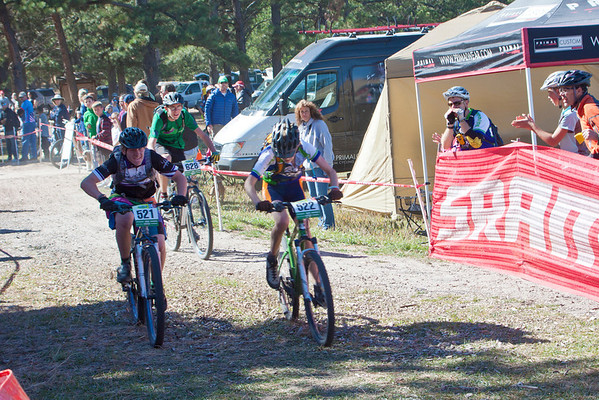 Sophmore riders Tye McAllister, 521 Salida High School and Will McDonald, 522 of Laramie battle to the finish. Photo by Carrie Dittmer.