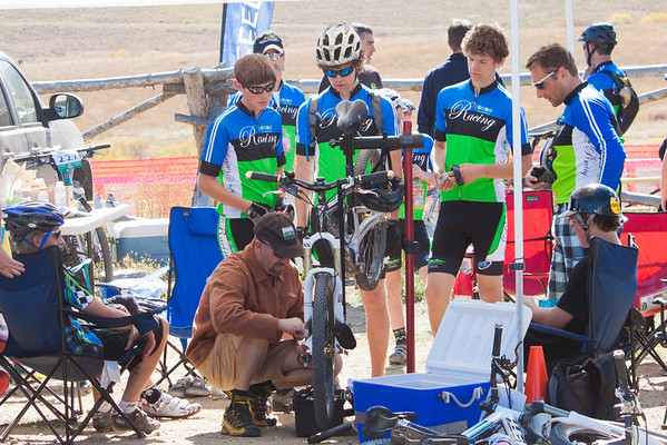 Team Evergreen mechanic preps racers' bikes. Credit: Brian Mazanti, BMaz Photography
