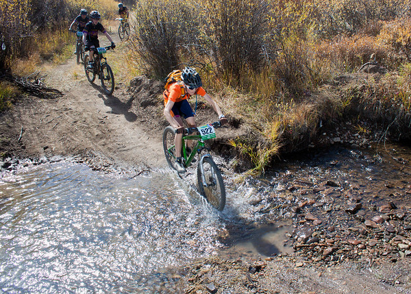 Will McDonald, Sophomore from Laramie's 7220 Team crosses Pole Creek. Credit: Brian Mazanti, BMaz Photography