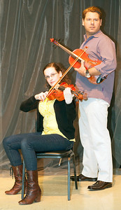 Violist Grace (played by Caitlin Mickey) occupies the chair formerly held by Dorian (Stephen Peirick), the most gifted but also most temperamental player in the Lazara String Quartet.  The group has replaced Dorian as it begins preparation for its most important concert ever, but Dorian may not be gone for good.  The West End Players Guild presents Michael Hollinger's Opus, directed by Jerry McAdams, April 5-14 at the theatre in the Union Avenue Christian Church.  (Photo by John Lamb)