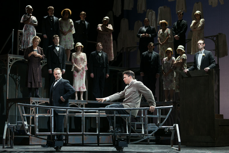 """L to R (foreground): Thomas Richards as Orville Mason, Christian Bowers as Clyde Griffiths, Matthew Scollin as Judge in The Glimmerglass Festival's new production of Tobias Picker's """"An American Tragedy."""" Photo: Karli Cadel/The Glimmerglass Festival."""
