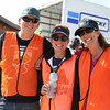 Volunteers at the finish line welcomes every racer as the complete their race. Photo Leslie Farnsworth-Lee.