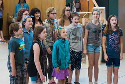 Music Director Joseph Colaneri works with the youth chorus members of La bohème . Photo: Karli Cadel/The Glimmerglass Festival.