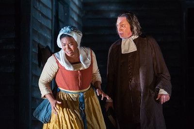 """Zoie Reams as Tituba and David Pittsinger as Reverend John Hale  in The Glimmerglass Festival's production of Robert Ward's """"The Crucible."""" Photo: Karli Cadel/The Glimmerglass Festival"""