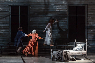 """L to R: Frederick Ballentine as Reverend Samuel Parris, Ariana Wehr as Abigail Williams, Mary Beth Nelson as Betty Parris in The Glimmerglass Festival's production of Robert Ward's """"The Crucible."""" Photo: Karli Cadel/The Glimmerglass Festival"""
